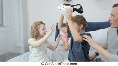 Brother Giving Sister Virtual Reality Glasses While Spending...