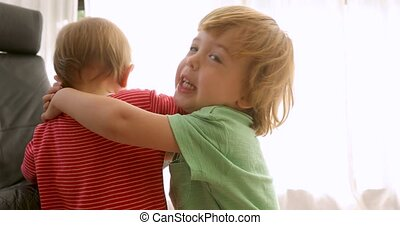 Brother hugging sister playing on white background
