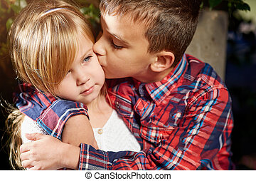 Brother kisses his sister, family relationships