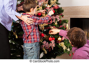 Brother placing baubles on the tree