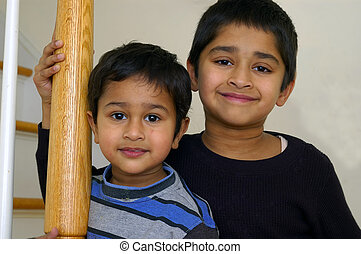Brother - Portrait of two indian brothers on a light back...