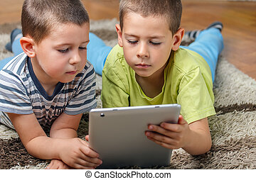 Brother using modern tablet computers