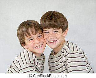 Brothers Against a White Background