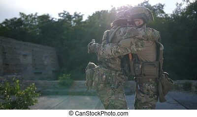 Brothers in arms meeting after combat at sunset - Positive...