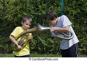 brothers playing on the  horn