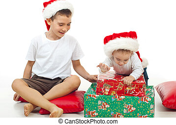 Brothers playing with Xmas gifts