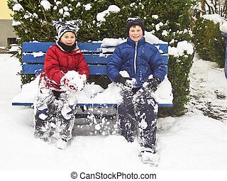 brothers sitting in winter on a bench