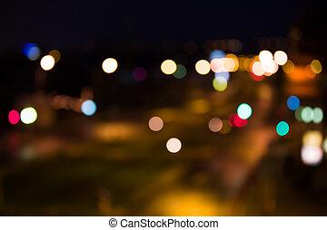 brouillé, route, à, lumières ville, soir