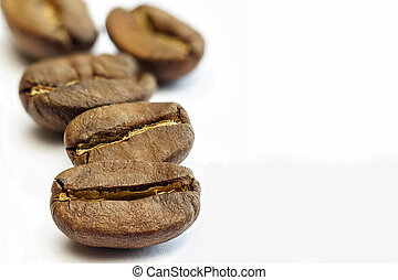 Broun coffee beans isolated on white background. shallow...