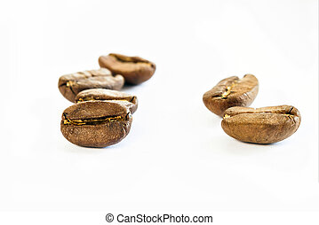 Broun coffee beans isolated on white background shallow depth of field