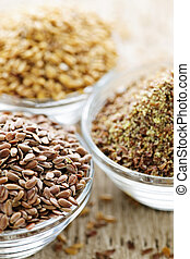 Brown and golden flax seed - Bowls of whole and ground flax ...