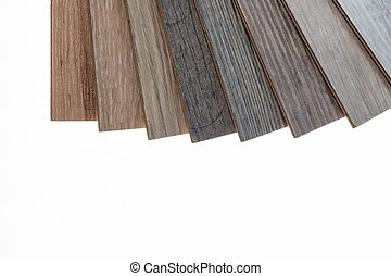brown and grey laminate flooring samples on white background