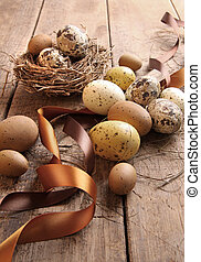 Brown and yellow eggs with ribbons for easter
