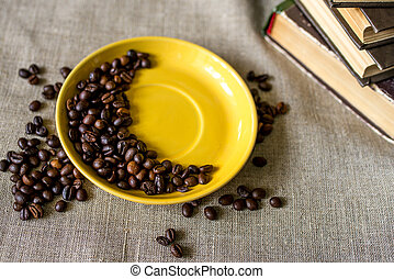 coffee with beans on wooden background