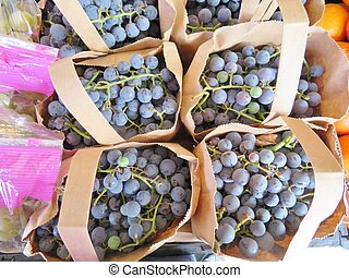 Brown bags filled with tags of grapes