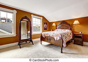 Brown bedroom with carved wood furniture