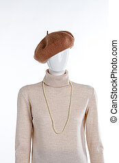 Brown beret and beige sweater.