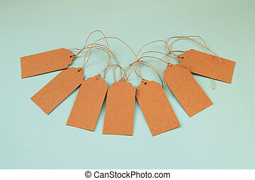 Brown blank paper price tags or labels set on the blue background.