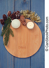 brown board with Christmas decoration on blue background