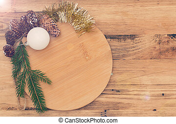 brown board with Christmas decoration on brown wooden background