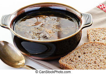 Brown bowl of mushroom soup