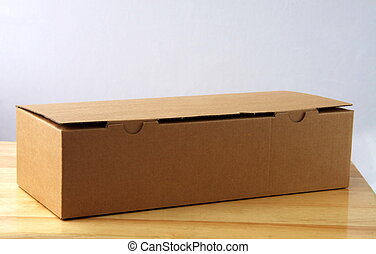 brown box - brown cardboard box on a wooden table with...