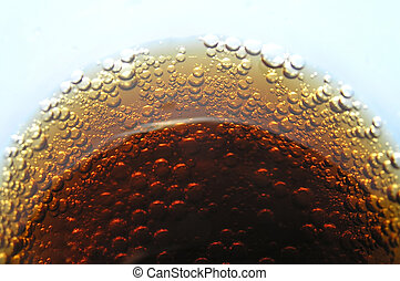 Brown bubbles - A perspective shot of a glas of cola with...