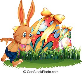 Brown bunny and easter eggs