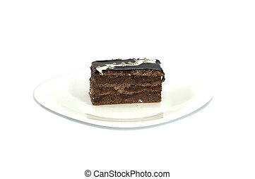 brown cake with pearls on a white plate