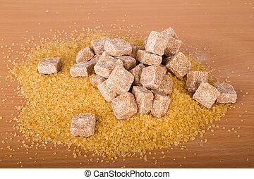 Brown cane sugar cubes and crystal sugar