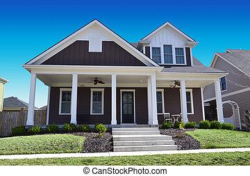 Brown Cape Cod Style Dream Home