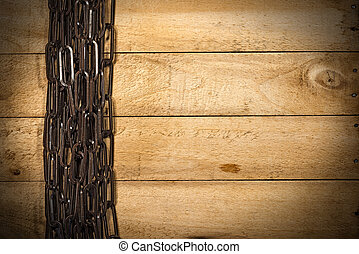 Brown Chain on a Wooden Background