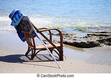 Brown chair near sea