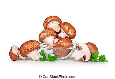 brown champignons  mushrooms in a glass bowl isolated on white background
