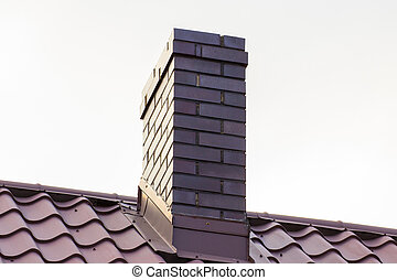 Brown chimney on roof of house