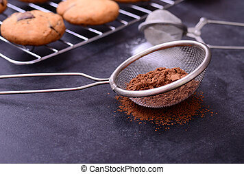 Brown chocolate powder on black background