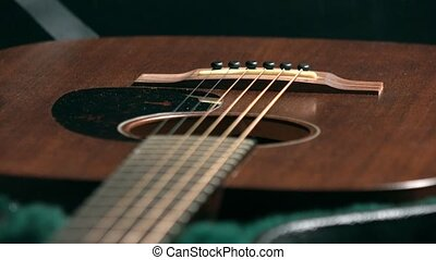 Brown classic guitar in the case. 4K racking focus video -...