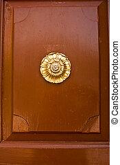 Brown Colonial Door with Gold Sunburst