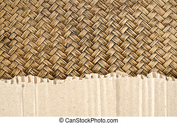 Brown Corrugated paper on bamboo woven background