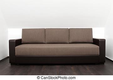 brown couch in bright white interior