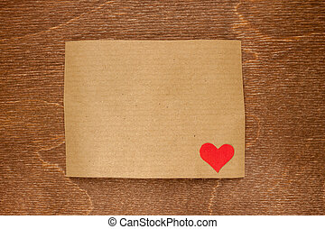 brown craft paper on wooden background