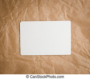 Brown craft paper with a blank tag on a white background