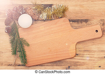 brown cutting board with Christmas decoration on brown wooden background