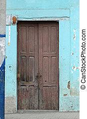 Brown Door in a Blue Wall