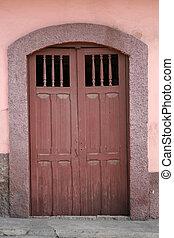 Brown Door in a Painted Wall