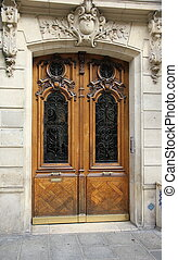 Brown door with wood carving