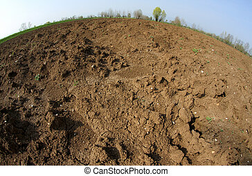 Brown Earth from the farmer ploughed before sowing the seeds for the autumn harvest