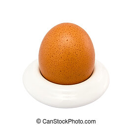 Brown egg in egg cup on a white