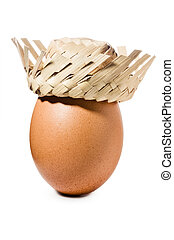 Brown egg with straw hat isolated on white background