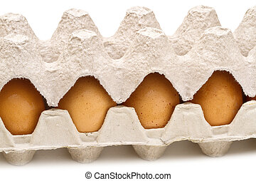 Brown eggs in a carton package on white background
